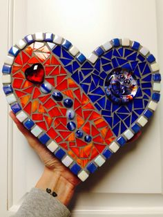 Mosaic heart for my youngest son using his blown glass smiley face :)