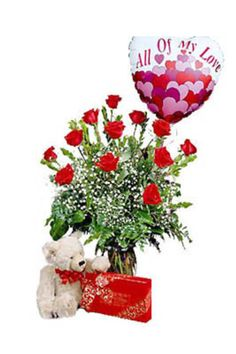 Say 'I Love You' with this sure-fire combination. One dozen beautiful red roses arranged with accents, a lovable teddy bear, chocolates, and a mylar balloon, too.     #teddybear #lovebear #roses #candy #anniversary #gifts