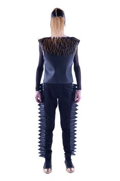 In addition to geometric motifs, designer Marcos Paulo infuses gold spikes and futuristic cuts to tie together the intergalactic warrior look, which has influenced each piece.