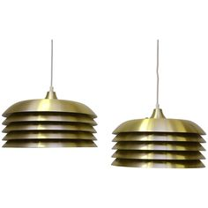 Pair of Hans-Agne Jakobsson Brass Pendants, 1960s   From a unique collection of antique and modern chandeliers and pendants at https://www.1stdibs.com/furniture/lighting/chandeliers-pendant-lights/