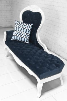 Velvet navy and white tufted chaise lounge.
