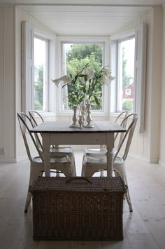 My Style | KITCHEN & DINING :: Vintage Tolix chairs. GOOD IDEA: A basket at the end of a dining table for extra storage.
