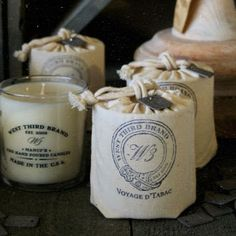 West Third Brand Candles - Choice of six fragrances. 10 oz. All cotton wick. Packaged in hand-stamped cotton sack.