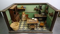German kitchen with unusual green walls, pre-1945.  Original stove and furniture.  Size: high 60cm x 39cm x 32cm.