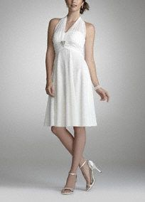 This is one dress that is sure to be your go-to favorite time and time again.   Illusion halter neckline ties in the back for a perfect fit.  Charmeuse trim and beaded brooch detail accent the empire waist of the short and flirty skirt.  Imported polyester. Fully lined. Hand wash only. Also available in plus sizes as Style 9006DB0W.