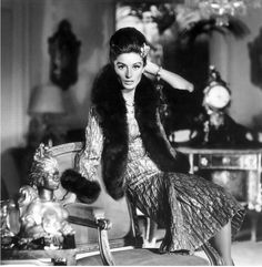 1963 Anouk Aimee wearing gold brocade dress and fur-trimmed jacket by Chanel, photo by Henry Clarke for Vogue