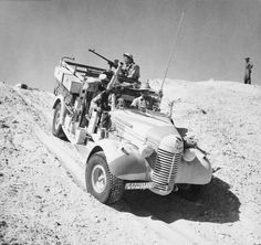 A Long Range Desert Group Chevrolet 30cwt 1533 truck negotiates the slope of a sand dune during a patrol in the desert 27 March 1941.