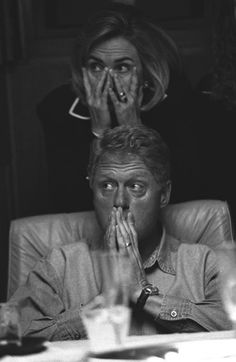 Bill and Hillary Clinton listen to a briefing about the 1996 election aboard Air Force One | Photo credit: Bob McNeely