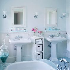 Cottage Bath with Twice the Style- Matching pedestal sinks, clear-glass shelves, and mirrored medicine cabinets separated by a simple storage unit offer a symmetry that's pleasing to the eye without taking up much space in this modest-size bathroom. The placement of the sconces on each side of the mirrors means they can do double duty, providing both task lighting and ambient lighting.