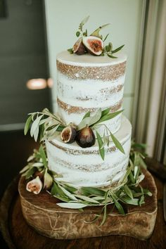 Naked Fig and Olive Leaf Wedding Cake by Eleos Cakes Instagram @eleoscakes | Rustic Cake Board available for hire from http://www.thesmallthings.co | Melbourne based wedding hire company