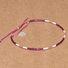 Bracelet jonc perles miyuki fil nylon rose foncé breloque quartz