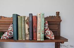 DIY bookends- I wonder if rice is heavy enough (instead of sand).....