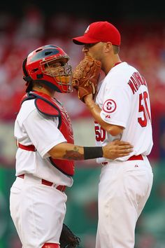 Yadier Molina and starter Adam Wainwright both of the St. Louis Cardinals meet on the mound after Wainwright gave up back-to-back home runs in the first inning at Busch Stadium on June 2013 in St. St Louis Baseball, St Louis Cardinals Baseball, Chicago Cubs Baseball, Stl Cardinals, Nfl Football, Cardinals Players, Baseball Equipment, Yadier Molina, National League