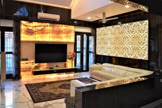 To add to the luxury and vibrant quotient the wall towards right side of the TV unit adorns another backlit jali pattern with onyx by A.J Architects. Luxury Interior, Interior Design, Common Area, Tv Unit, Large Windows, Luxury Living, Second Floor, Ground Floor, Living Area