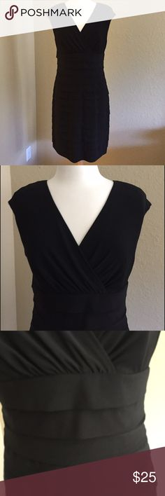Classic Black Dress Beautiful Classic black evening dress with cap sleeves.  Perfect for special occasions. Wear with patent leather heels and bold gold jewelry. Dress is slimming 95% polyester 5% elastane. Dress sits above knees.   Nonsmoking *** American Living Dresses