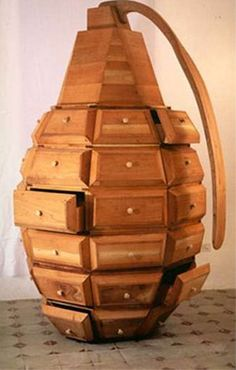 This unique wooden sculpture also qualifies as furniture. Clearly representing a grenade, it's made up of 36 individual drawers and was constructed by Cuban collective, 'Los Carpinteros'