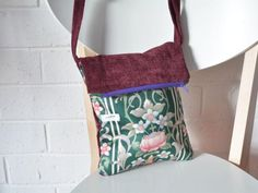 Round She Goes - Market Place - Heather. Small fold over zipper messenger with front pocket and adjustable strap. Shoulder or cross-body bag. Reclaimed upcycled fabric.