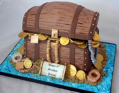 Treasure-chest cake. Love, love, love the way they gilded the candy necklaces and rings. Really creative.
