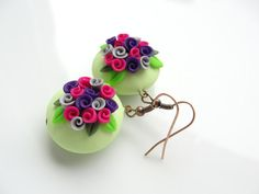 Lime green lentil beads with pretty bright pink and purple roses handmade from polymer clay. The rose bead has been handsculpted and is hung from antique copper coloured findings. The earrings are approx 1 & 3/4 inches (4.4cm) long from the top of the ear wire to the bottom of the earring.