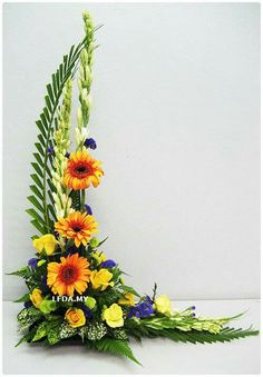 Asymmetrical Arrangement Sunflower Yellow Roses Queen Anne's Lace Purple Stock