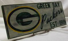 The Green Bay Packers. This sign is hand painted on cabinet grade birch and measures 6 1/2  x 17 . This sign is hand painted with quality green,