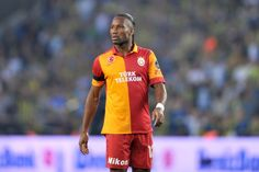 Didier Drogba in Galatasaray outfit. Football Players, Polo Shirt, Soccer, Sports, Mens Tops, Outfits, African, Football Soccer, Hs Sports
