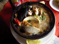 Paila Marina  Chilean Seafood Stew.  Seasoning with cilantro, chilli,  lemon juice and a little bit of wine
