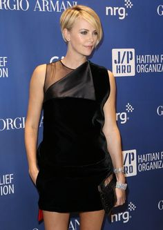 Oh, Charlize. You look awesome. (Givenchy mini-dress)