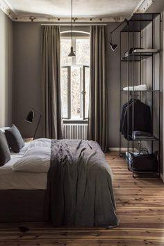 Color scheme. Bedding. Open shelving closet with coat hanger. Kind of cool.