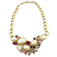 1970's Yves Saint Laurent link chain necklace with a cluster of pink and purple cabochons with clear aurora borealis, accented with pearls.