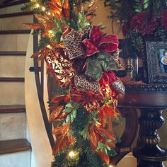 Christmas Staircase- Ribbon and glittered bay leaves are all this staircase needs to be decorated for Christmas with a beautifully lit garland. #ChristmasDecorating, #ChristmasStaircase