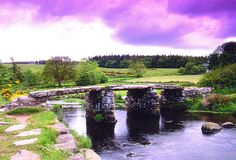 """THE CLAPPER BRIDGE, Two Bridges, Dartmoor, Devon    Clapper bridges have stood, in one form or another, for centuries. A """"Clapper Bridge"""" is a term used on Dartmoor for a bridge, which has one or more flat stone slabs resting on stone piers, and spanning a stream or river"""