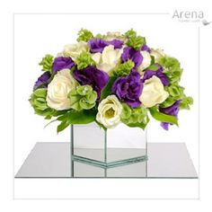 Bells of Ireland, Lisianthus and Roses  Purple & Green centerpieces