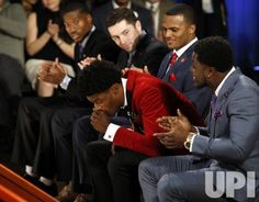 Louisville Cardinals quarterback Lamar Jackson reacts when he wins the Heisman Trophy award in New York City on December 10, 2016. The…