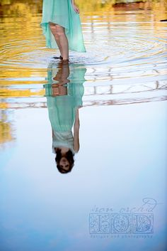 Gorgeous water reflections photography where top half of subject is cropped to put focus on the water's reflected image of the woman in long pale blue dress. - DdO:) - http://www.pinterest.com/DianaDeeOsborne/dido-reflections/ - Notice also that Blue - Golden orange color wheel combo gives peaceful art photo. CREDIT: Pinned via Amber Hagen.
