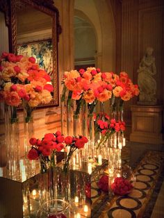 A reminder of what Jeff Leatham has been up to this year at the Hotel  Georges V, Paris. What I love about his work is that it is completely  foreign to me: I would not know what to do with chandeliers and mirror and  marble surrounds. The man knows how to work flowers with bling. I am deeply  i