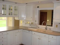 Skinny townhouse kitchen with passthrough to family room