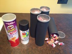 "Start with Pringles canister, spray paint a matte black, add atomic fire balls and you have easy party favors (a paintball ""hopper"" with ""paintballs"") for a teen's paintball party!"
