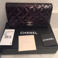 100% authentic Chanel wallet - 1 day sale 100% authentic gently used Chanel wallet in black patent with silver emblem. With original box, dust cover, authenticity cards and tag. Purchased from Chanel store. 8 credit card compartments. 1 zipper compartment for coins. 5 bigger compartments for cash or check book. No trades. No refunds. No exchanges. No returns. No pay pal. CHANEL Bags Wallets