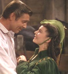 """""""Gone With the Wind"""": Vivian Leigh/Scarlett O'Hara  Clark Gable/Rhett Butler  Scarlett: Now I didn't come to talk silliness about me, Rhett. I came 'cause I was so miserable at the thought of you in trouble. Oh, I know I was mad at you the night you left me on the road to Tara, and I still haven't forgiven you!  Rhett Butler: Oh, Scarlett! Don't say that!  Scarlett: Well I must admit I might not be alive now, only for you. And when I think of myself with everything I could possibly hope for…"""