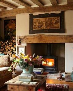 I tell you I'd rather have a wood burning stove than a fireplace. I love this country cottage living room and the log storage! English Cottage Style, English Country Cottages, English Country Decor, English Cottage Interiors, English Cottage Decorating, French Country, Cottage Fireplace, Farmhouse Fireplace, Country Fireplace