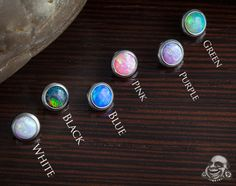 4mm or 5mm white opal, set of 2. Available at bodyartforms.com