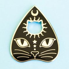 "Communicate+with+kitties+from+the+great+beyond+with+this+cat+planchette+pin.+Bring+a+little+witch+cat+magic+into+your+day+and+into+your+pingame.+(Spirit+contact+not+guaranteed!+:)  Hard+enamel+pin+measures+1""+x+1+1/4""+(2.5cm+x+3cm)+and+is+made+from+silver-toned+metal.  Order+the+planchette+on..."