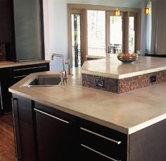 poured concrete kitchen counters | Search :: Profoundit.  Just the countertop color...not the kitchen configuration or backsplash