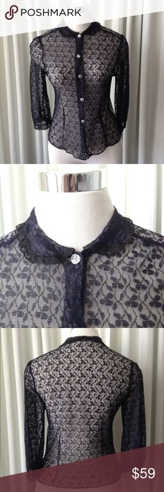 """Vintage 50's blue lace blouse size XS/S Vintage 50's blue lace blouse with black Lace trim at the collar, clear buttons, 3/4 sleeves, perfect conditions, looks like a Small lace stretch  Measurement  Arm pit to arm pit 16"""" Length 21"""" Waist 14.5"""" Sleeve from shoulder 16"""" Shoulder 14"""" unbranded Tops Blouses"""