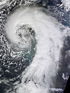 ~~Extratropical Cyclone over the United Kingdom ~ these types of cyclones result in comma-shaped cloud formations - bearing down on the UK February 12, 2014 by NASA Goddard Photo and Video~~