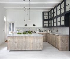 foxgrove-kitchen-remodelista Love the mixed textures.  Marble with distressed wood