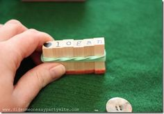 Hold mini letter stamps together w/rubber band to make the word straight. - duh.  genius.