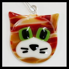 Absolutely adorable fused-glass cat! Perfect for the cat lover to use as a tree ornament or hang in a special place to enjoy all year!