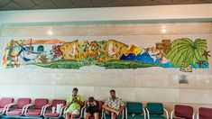 Paul Goodnight's mosaic mural is a hidden gem in Orlando's airport. Created in 2000, it is made out of Italian smalti and is near Gate 112. This tropical themed mosaic is 27-feet long and depicts alligators, fishing boat, fish, palm trees, birds, and flowers. See close ups here!